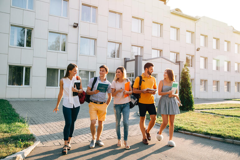 free-time-students-bachelor-s-campus-life-rhythm-five-friendly-students-are-walking
